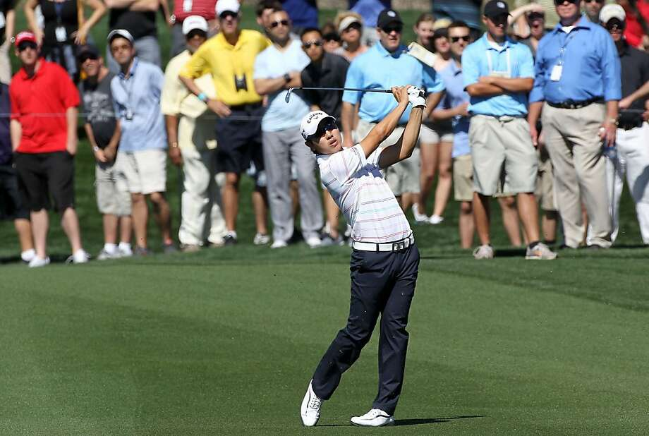 Sang-moon Bae of South Korea hits an approach shot on the seventh hole during the quarterfinal round of the World Golf Championships-Accenture Match Play Championship at the Ritz-Carlton Golf Club on February 25, 2012 in Marana, Arizona.  (Photo by Sam Greenwood/Getty Images) Photo: Sam Greenwood, Getty Images