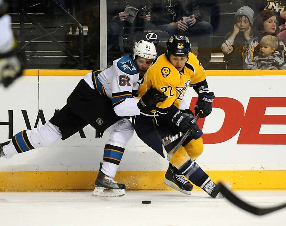 San Jose Sharks defenseman Justin Braun (61) collides with Nashville Predators right wing Jordin Tootoo (22) in the second period of an NHL hockey game on Saturday, Feb. 25, 2012, in Nashville, Tenn. (AP Photo/Mike Strasinger) Photo: Mike Strasinger, Associated Press