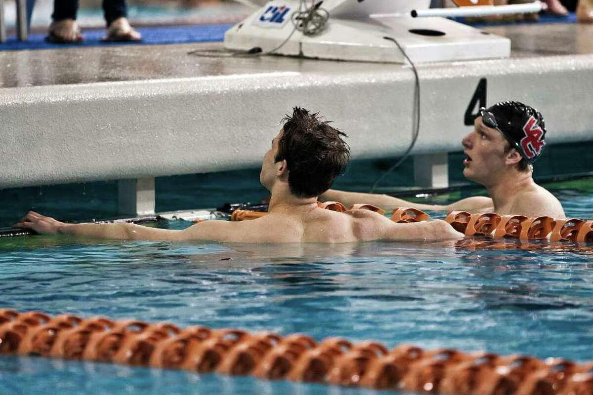 Churchill's John Murray (left) and Cory Bolleter look to the scoreboard following the boys' 50-yard freestyle in the finals of the 5A Swimming and Diving State Meet at the Jamail Texas Swim Center in Austin on Saturday, Feb. 25, 2012. Murray was disqualified due to a false start and Bolleter was declared the winner with the time of 20.59.