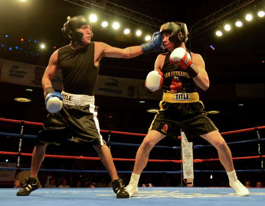 Gabriel Delgado (left) lands a punch to the head of David Murillo (right) during the novice 141-pound lightweight bout at the San Antonio Regional Golden Gloves Championship at the Scottish Rite Cathedral on Saturday, Feb. 25, 2012. Photo: John Albright, For The Express-News