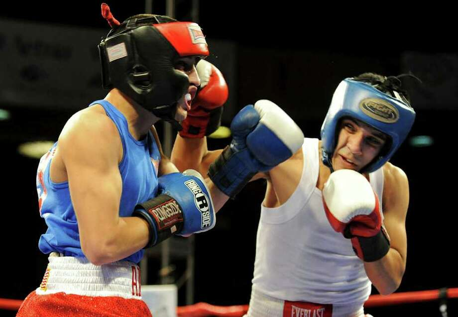 Joseph Rodriguez (right) lands a punch to the face of Rafael Anzures (left) during the open 123-pound bantam bout at the San Antonio Regional Golden Gloves Championship at the Scottish Rite Cathedral on Saturday, Feb. 25, 2012. Photo: John Albright, For The Express-News