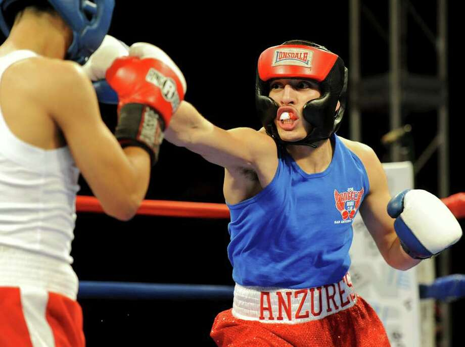 Rafael Anzures throws a punch at Joseph Rodriguez during the open 123-pound bantam bout at the San Antonio Regional Golden Gloves Championship at the Scottish Rite Cathedral on Saturday, Feb. 25, 2012. Photo: John Albright, For The Express-News