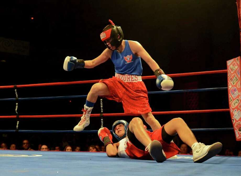 Rafael Anzures steps over Joseph Rodriguez after knocking him down during the open 123-pound bantam bout at the San Antonio Regional Golden Gloves Championship at the Scottish Rite Cathedral on Saturday, Feb. 25, 2012. Photo: John Albright, For The Express-News