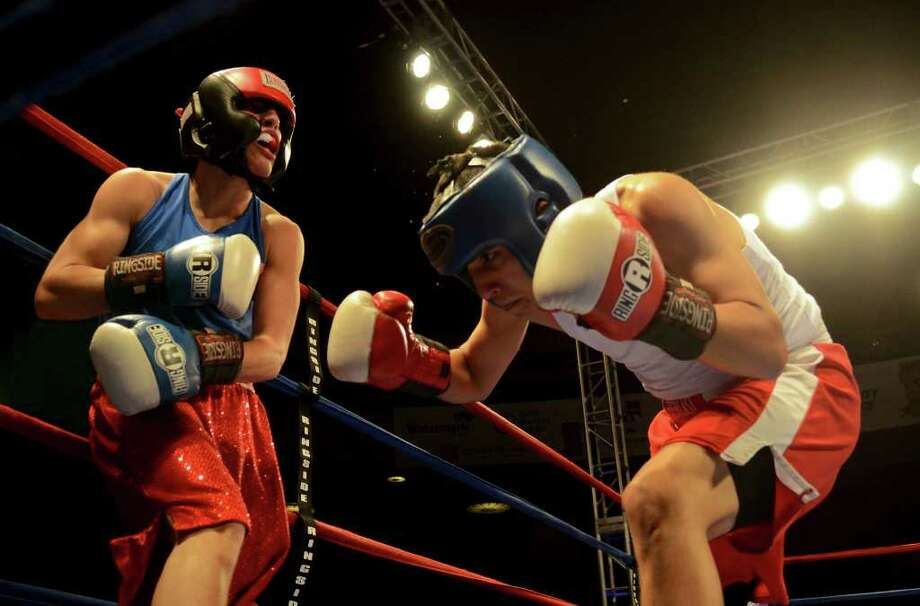 Joseph Rodriguez (right) ducks a punch by Rafael Anzures (left) during the open 123-pound bantam bout at the San Antonio Regional Golden Gloves Championship at the Scottish Rite Cathedral on Saturday, Feb. 25, 2012. Photo: John Albright, For The Express-News