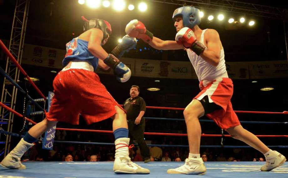 Rafael Anzures (left) and Joseph Rodriguez (right) during the open 123-pound bantam bout at the San Antonio Regional Golden Gloves Championship at the Scottish Rite Cathedral on Saturday, Feb. 25, 2012. Photo: John Albright, For The Express-News