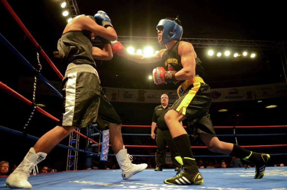 Kendo Castaneda (right) tries to land a punch to the head of Christian Santibanes (left) during the open 132-pound lightweight bout at the San Antonio Regional Golden Gloves Championship at the Scottish Rite Cathedral on Saturday, Feb. 25, 2012. Photo: John Albright, For The Express-News