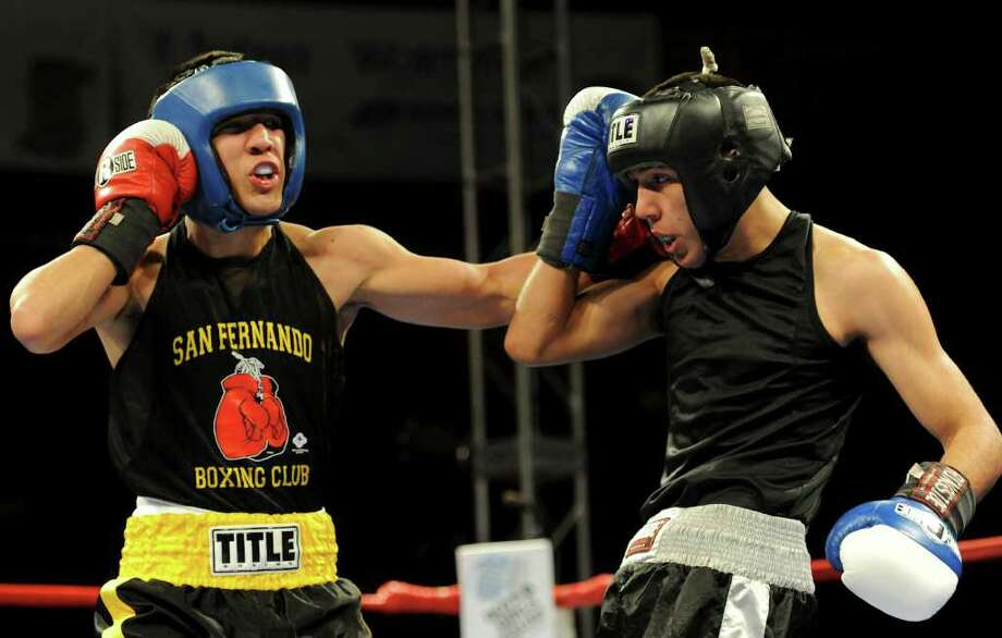 "Kendo Castaneda (left) makes his pro debut Saturday. ""He's so good, after two or three fights he's going to be the best fighter in San Antonio,"" said ""Jesse"" James Leija, Castaneda's trainer. Express-News file photo Photo: John Albright, For The Express-News"