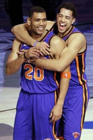 New York Knicks guard Landry Fields, right, hugs former Knicks guard Allan Houston (20) after winning the NBA All-Star Shooting Stars basketball competition in Orlando, Fla., Saturday, Feb. 25, 2012. (AP Photo/Chris O'Meara) (AP) / SA