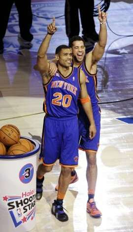 New York Knicks guard Landry Fields, right, celebrates with former Knicks guard Allan Houston (20) after winning the NBA All-Star Shooting Stars basketball competition in Orlando, Fla., Saturday, Feb. 25, 2012. (AP Photo/Chris O'Meara) (AP) / SA