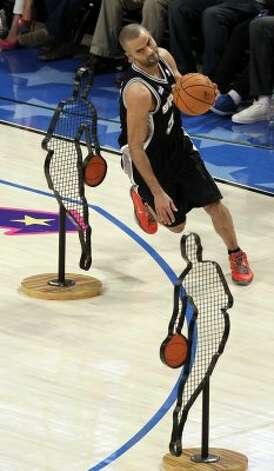 San Antonio Spurs' Tony Parker (9) participates in the NBA All-Star Skills Challenge basketball competition in Orlando, Fla., Saturday, Feb. 25, 2012. (AP Photo/Chris O'Meara) (AP) / SA