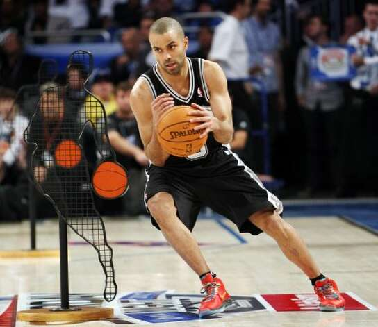 San Antonio Spurs' Tony Parker (9) participates in the NBA All-Star Skills Challenge basketball competition in Orlando, Fla., Saturday, Feb. 25, 2012. Parker won the event. (AP Photo/Lynne Sladky) (AP) / SA