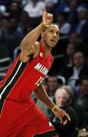 Miami Heat's Mario Chalmers gestures during the NBA All-Star Three-Point Shootout basketball competition in Orlando, Fla., Saturday, Feb. 25, 2012. (AP Photo/Lynne Sladky) (AP) / SA