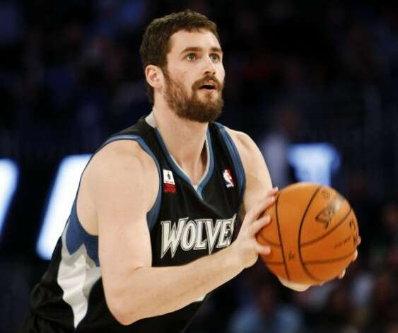 Minnesota Timberwolves' Kevin Love shoots during the NBA All-Star Three-Point Shootout basketball competition in Orlando, Fla., Saturday, Feb. 25, 2012. (AP Photo/Lynne Sladky) (AP) / SA
