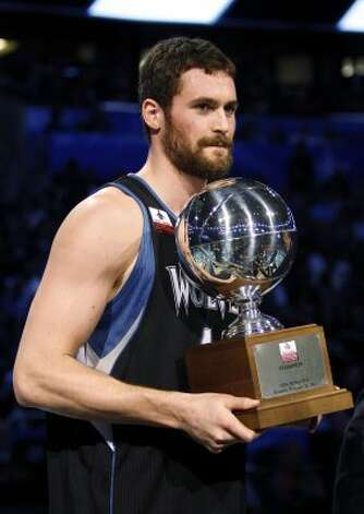 Minnesota Timberwolves' Kevin Love holds the NBA All-Star Three-Point Shootout basketball trophy after winning the event in Orlando, Fla., Saturday, Feb. 25, 2012. (AP Photo/Lynne Sladky) (AP) / SA