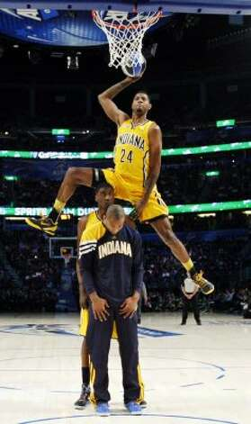 Indiana Pacers' Paul George jumps over two teammates during the NBA basketball All-Star Slam Dunk Contest in Orlando, Fla. Saturday, Feb. 25, 2012. (AP Photo/Jeff Haynes, Pool) (AP) / SA