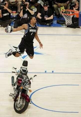 Minnesota Timberwolves' Derrick Williams jumps over a motorcycle during the NBA basketball All-Star Slam Dunk Contest in Orlando, Fla., Saturday, Feb. 25, 2012. (AP Photo/Chris O'Meara) (AP) / SA