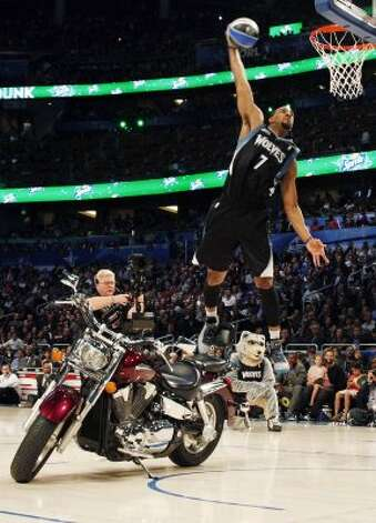 Minnesota Timberwolves' Derrick Williams jumps over a motorcycle during the NBA basketball All-Star Slam Dunk Contest in Orlando, Fla., Saturday, Feb. 25, 2012. (AP Photo/Lynne Sladky) (AP) / SA