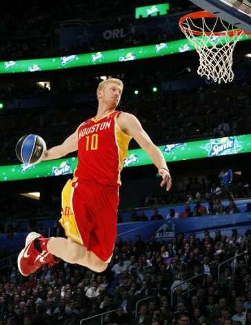 Houston Rockets' Chase Budinger (10) performs his attempt during the NBA basketball All-Star Slam Dunk Contest in Orlando, Fla., Saturday, Feb. 25, 2012. (AP Photo/Lynne Sladky) (AP) / SA