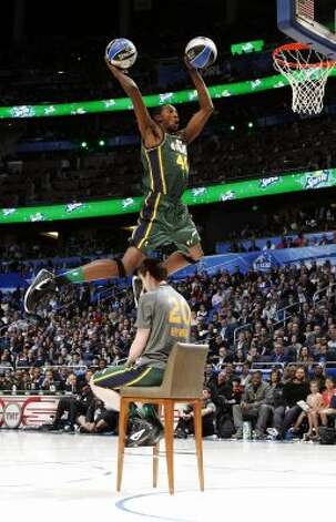 Utah Jazz's Jeremy Evans jumps over teammate Gordon Hayward for his attempt during the NBA basketball All-Star Slam Dunk Contest in Orlando, Fla., Saturday, Feb. 25, 2012. Evans earned 29 percent of 3 million text message votes cast by fans to win the competition. (AP Photo/Lynne Sladky) (AP) / SA