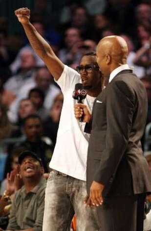 P. Diddy gestures during the NBA basketball All-Star Slam Dunk Contest in Orlando, Fla., Saturday, Feb. 25, 2012.(AP Photo/Lynne Sladky) (AP) / SA