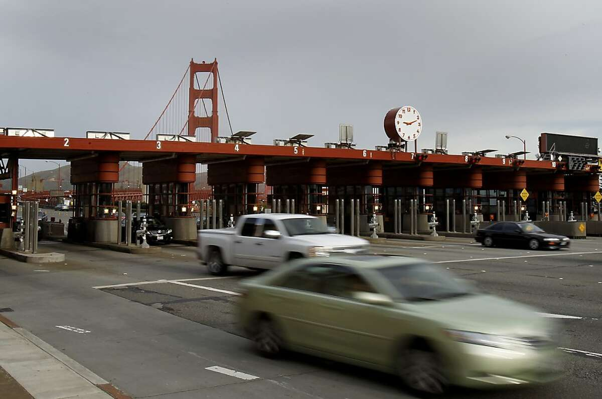Cars zoom away from the toll plaza at the Golden Gate Bridge, some pay, some use FasTrak. Toll collectors, like these at the Golden Gate Bridge, may be replaced by electronic/automated toll collection in the future.