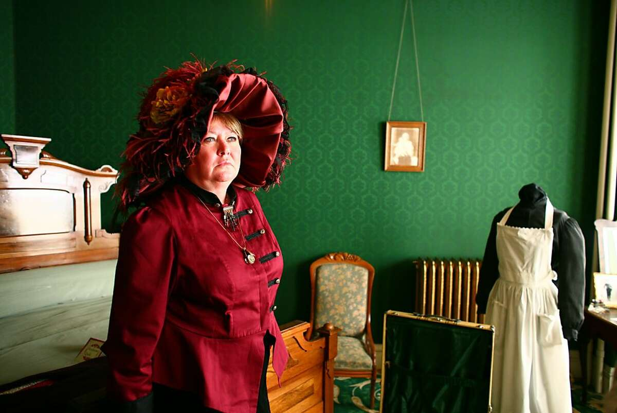 Janet Kalstrom plays Molly Brown, a Titanic survivor, inside Brown's bedroom for the Molly Brown House Museum in Denver, Feb. 14, 2012. Some experts cite the Titanic's tale as the source of how modern disasters are perceived, and people are paying their respects, from memorial cruises to new museum exhibits, as the anniversary of the ship's sinking approaches. (Matthew Staver/The New York Times)
