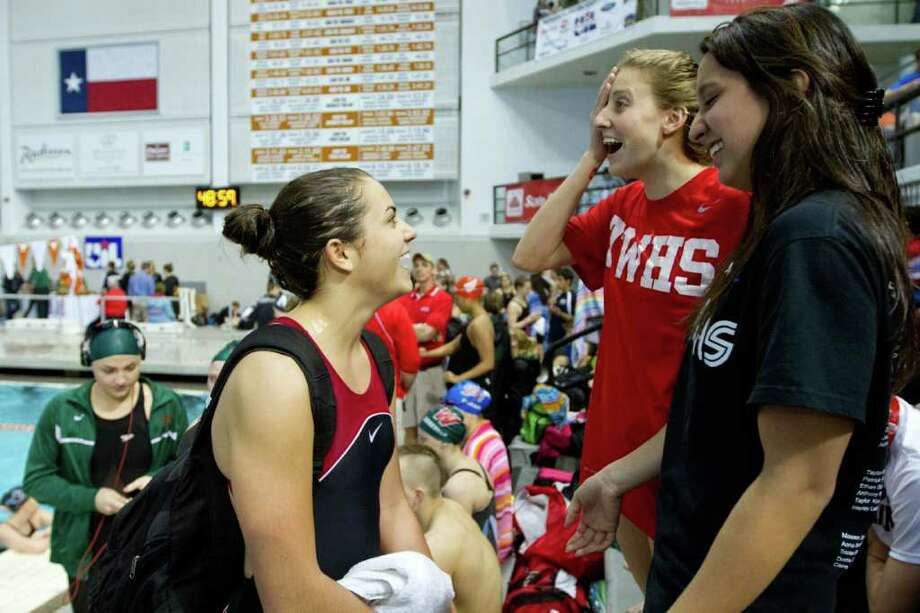 Kassidy Cook of The Woodlands, center,  celebrates with her teammates after winning the Girls 1-Meter Diving finals during the UIL State Swimming and Diving Championships at the Lee and Joe Jamail Texas Swim Center,  Saturday, Feb. 25, 2012, in Austin.  Cook won the event with a score of 594.50. Photo: Smiley N. Pool, Houston Chronicle / © 2012  Houston Chronicle