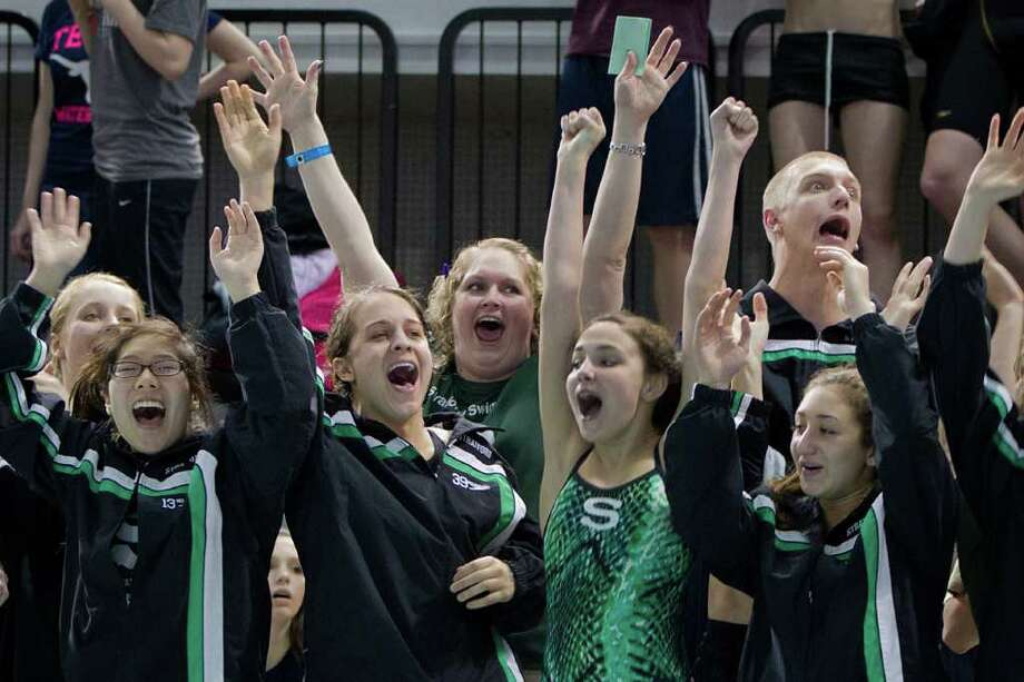 Stratford swimmers cheer as Ford Story wins  the 4A  Boys 100 Yard Breaststroke finals at the UIL State Swimming and Diving Championships at the Lee and Joe Jamail Texas Swim Center,  Saturday, Feb. 25, 2012, in Austin. Story set a state record in the event, and Stratford won the team title. Photo: Smiley N. Pool, Houston Chronicle / © 2012  Houston Chronicle