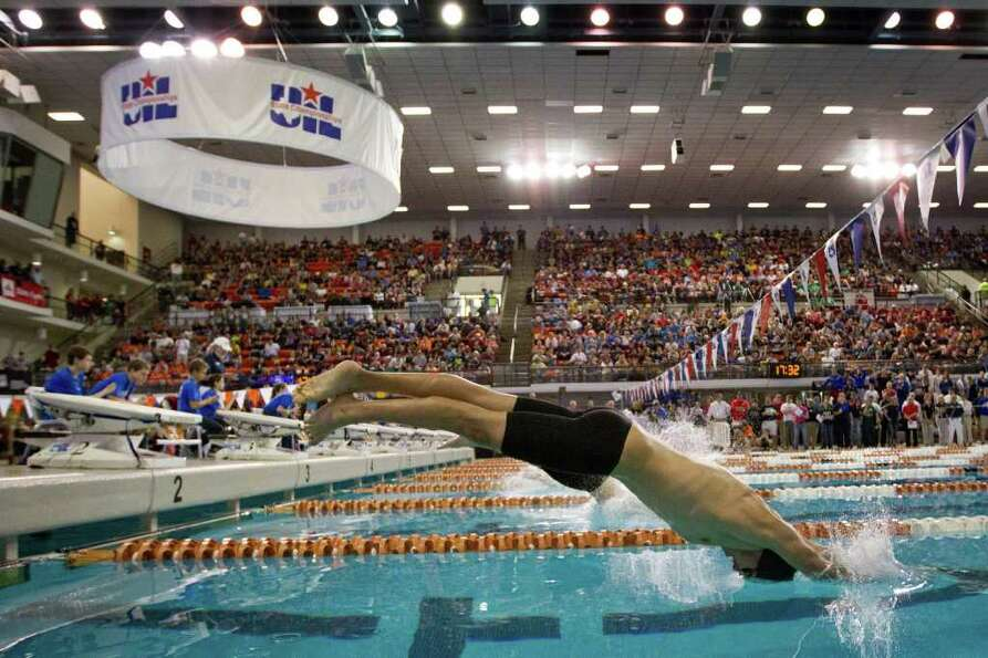 Anthony Ishikawa-Gu of Kingwood dives into the pool at the start of the 5A Boys 50 Yard Freestyle fi