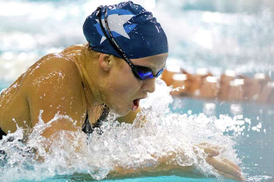 Romy Landeck of Clements swims the 5A Girls 100 Yard Breaststroke finals during the UIL State Swimming and Diving Championships at the Lee and Joe Jamail Texas Swim Center,  Saturday, Feb. 25, 2012, in Austin.  Landeck won the race with a time of 1:01.98. Photo: Smiley N. Pool, Houston Chronicle / © 2012  Houston Chronicle