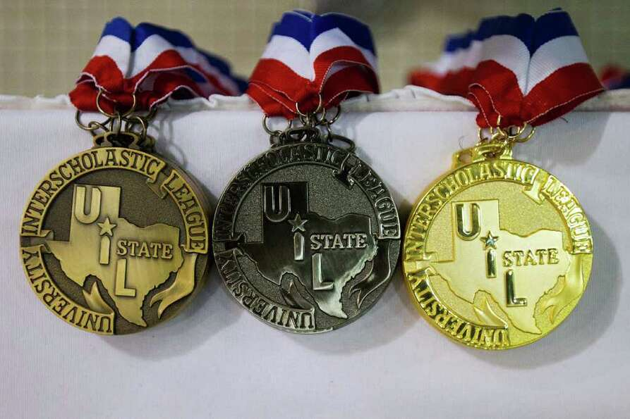 Stacks of medals await the winners of the 4A  Boys 400 Yard Freestyle Relay during the UIL State Swi