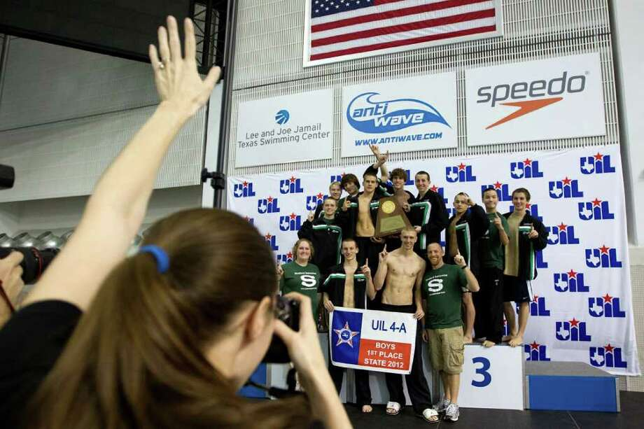 The winning Stratford team poses for a group photo after claiming the 4A Boys team title during the UIL State Swimming and Diving Championships at the Lee and Joe Jamail Texas Swim Center,  Saturday, Feb. 25, 2012, in Austin. Photo: Smiley N. Pool, Houston Chronicle / © 2012  Houston Chronicle