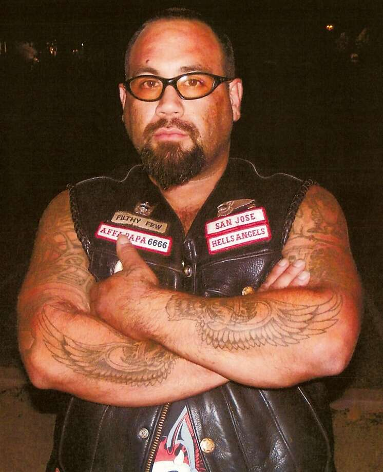 FILE – This undated file photo provided by the San Jose, Calif., Police Department shows Hells Angel Steve Ruiz. Ruiz is a suspect in the death of a motorcycle gang member. His arrest ends a months-long search for the victim's fellow Hells Angels member who has been wanted since the fatal shooting at a California funeral. (AP Photo/San Jose Police, File) Photo: Anonymous, Associated Press