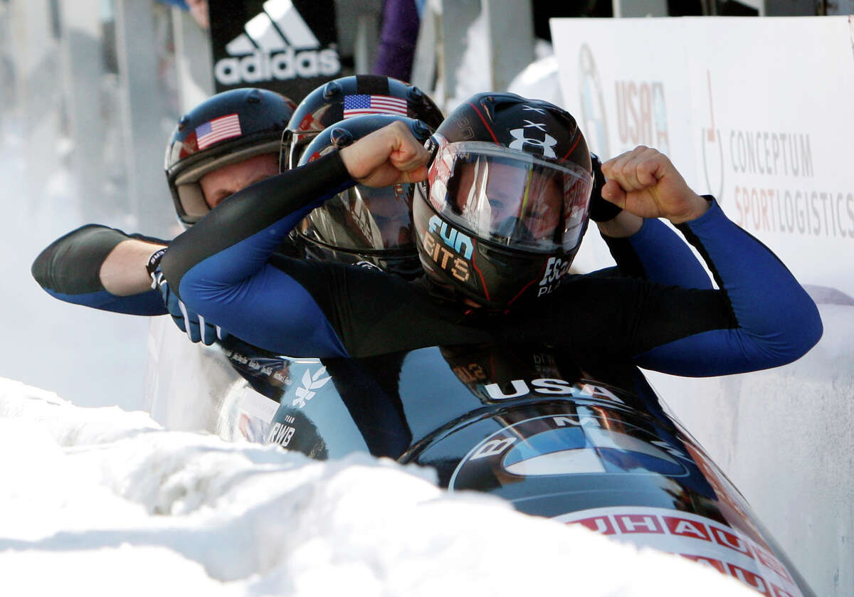United States' pilot Steven Holcomb, right, with pushers Justin Olsen, Steven Langton and brakeman Curtis Tomasevicz, react after winning the men's four-man Bobsled World Championships in Lake Placid, N.Y., on Sunday, Feb. 26, 2012.