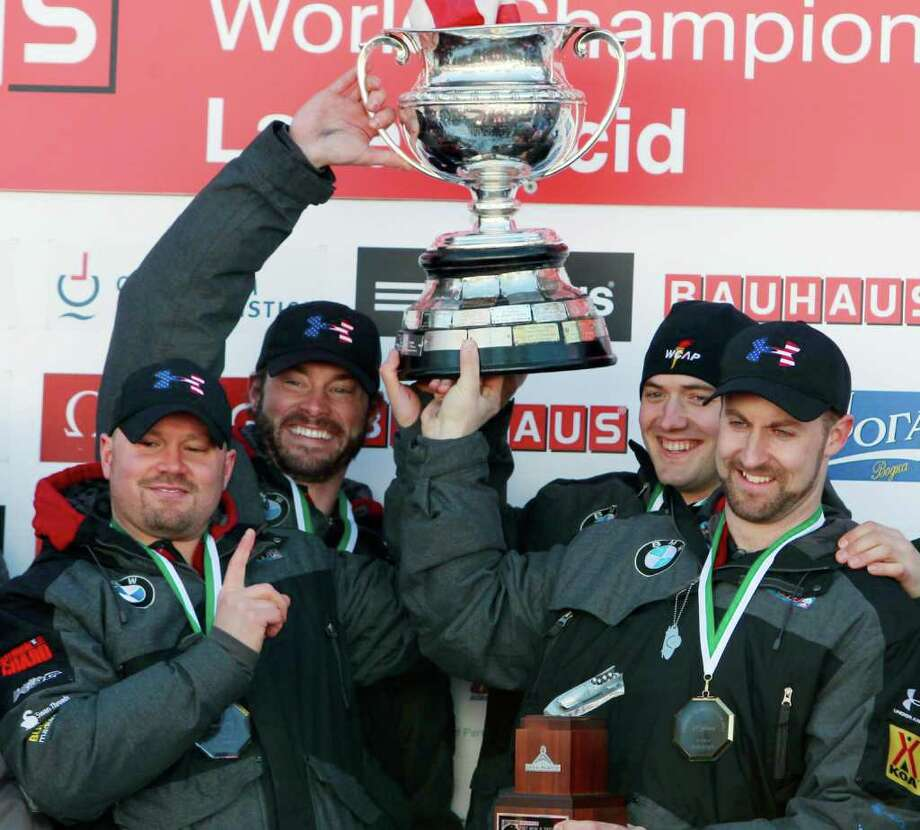 United States' men's four-man bobsled team holds the Martineau Cup after winning the bobsled world championships in Lake Placid, N.Y., on Sunday, Feb. 26, 2012.  From left to right, are: Steven Holcomb, Steven Langton, Justin Olsen and Curtis Tomasevicz. Photo: AP
