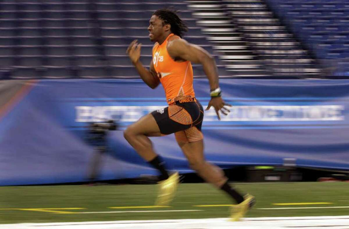 Baylor quarterback Robert Griffin III runs the 40-yard dash in 4.41 seconds at the NFL Scouting Combine in Indianapolis on Sunday.