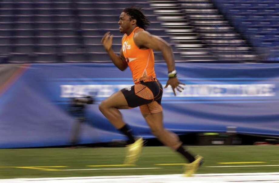 Baylor quarterback Robert Griffin III runs the 40-yard dash in 4.41 seconds at the NFL Scouting Combine in Indianapolis on Sunday. Photo: Michael Conroy, Associated Press