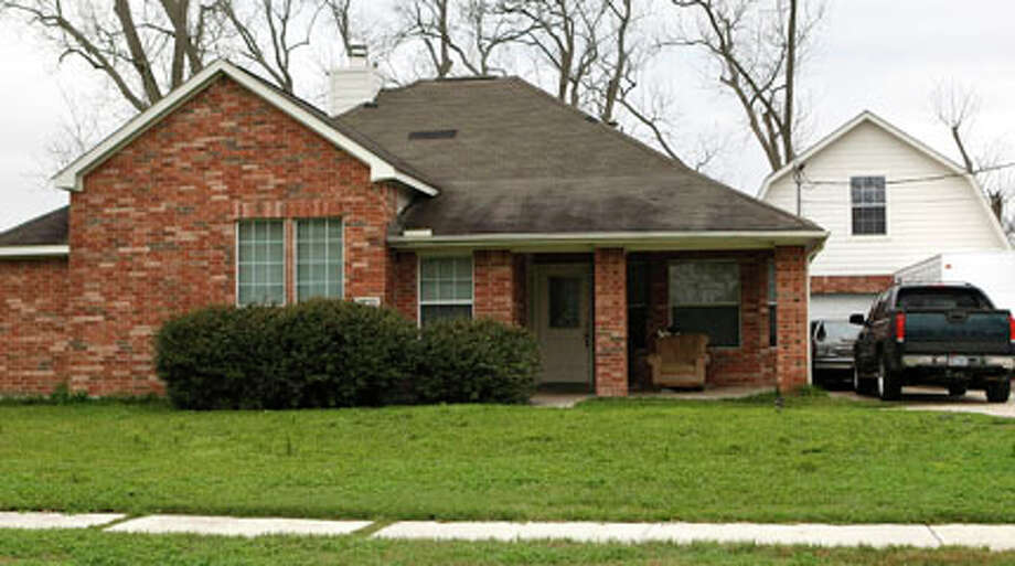 "On Jan. 24, investigators acted on a tip that children were being ""tied up"" in this house on Ford Avenue. (Johnny Hanson/Chronicle)  /  2012  Houston Chronicle"