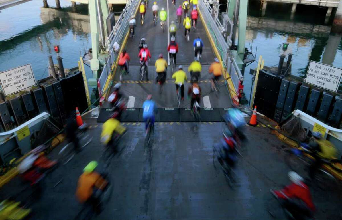 Cyclists begin the Chilly Hilly ride as they depart from the Bainbridge ferry on Sunday, Feb. 26, 2012.