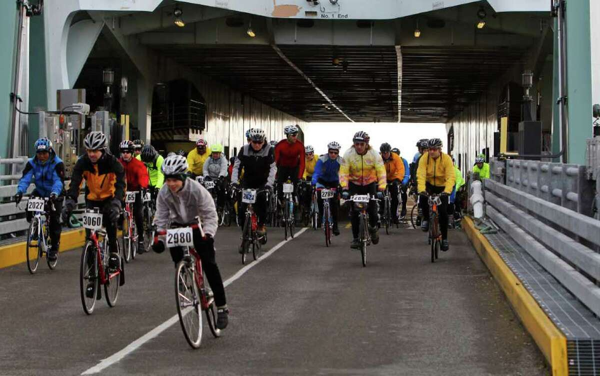 If you're a commuter, bike if you can Walking on sucks. It takes forever to load, and the line on a packed commuter boat feels like a slow moving herd of cows waiting to get into the barn. Biking on takes care of all of this. It's as cheap as a walk-on passenger (if you buy a monthly or multi-ride pass) and it provides some convenience of driving without the incredible cost. Plus, you only pay when leaving the city. You also to get to board and disembark first, shaving precious minutes off your commute time. If you live close to the ferry and work anywhere near downtown Seattle or Queen Anne, this is the way to go. Just watch out for the Lance Armstrong wannabes trying to beat you on to and off of the boat.