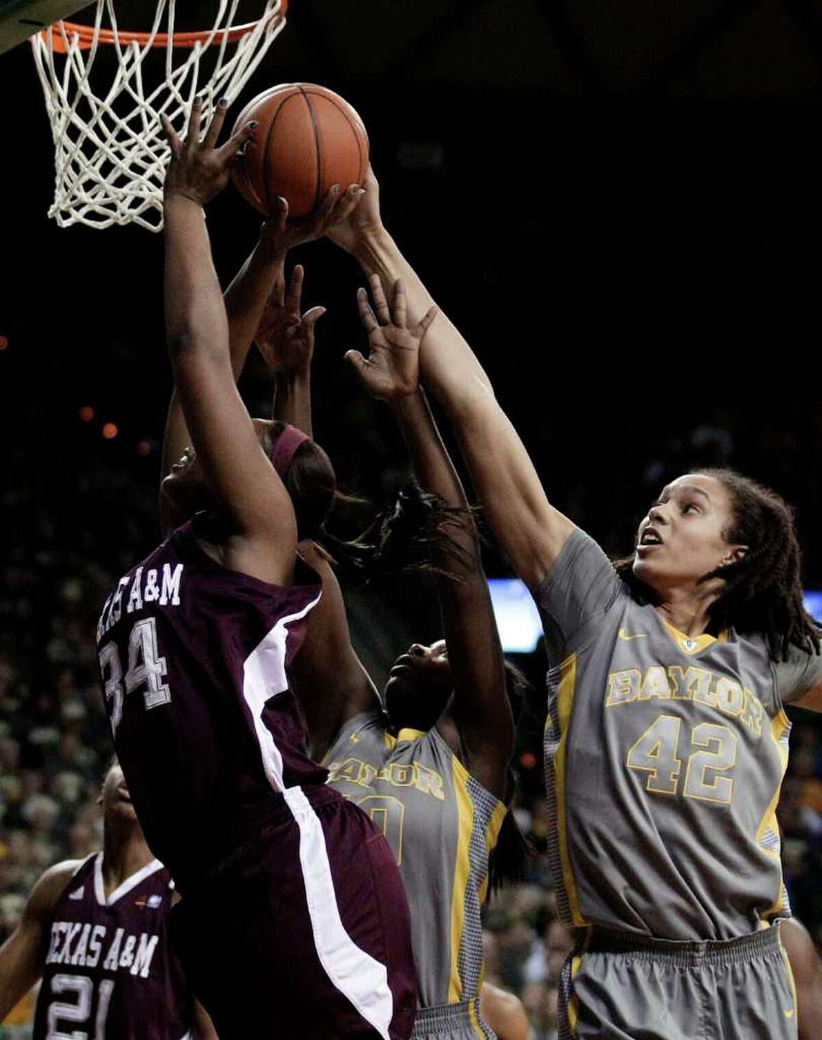 Baylor's Brittney Griner (right) blocks a shot by A&M's Karla Gilbert (left) in the teams' first meeting Feb. 11 in Waco.