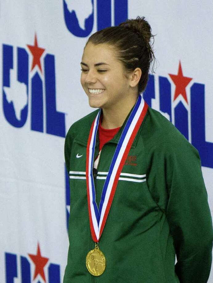 The Woodlands' Kassidy Cook is a two-time state diving gold medalist. Photo: Smiley N. Pool / © 2012  Houston Chronicle