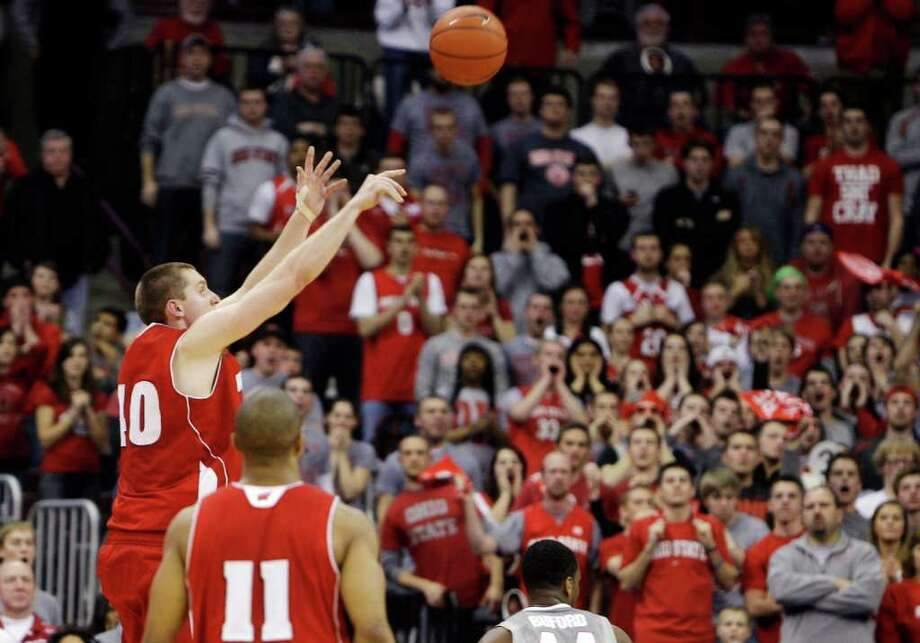 Wisconsin 6-foot-10 center Jared Berggren puts up a 3-pointer against Ohio State in the second half. Photo: AP