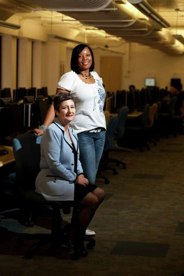 Jimaya Tates, right, is finishing her bachelor's degree at UH-D, through a program for people who had some college credits but not a degree. Karen Kaser, left, is the interim director of the program. Photo: Eric Kayne / © 2011 Eric Kayne