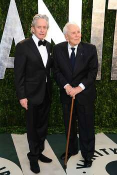 WEST HOLLYWOOD, CA - FEBRUARY 26:  Actors Michael Douglas (L) and Kirk Douglas arrive at the 2012 Vanity Fair Oscar Party hosted by Graydon Carter at Sunset Tower on February 26, 2012 in West Hollywood, California.  (Photo by Alberto E. Rodriguez/Getty Images) Photo: Alberto E. Rodriguez, Getty Images