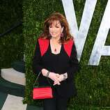 WEST HOLLYWOOD, CA - FEBRUARY 26:  Author Jackie Collins arrives at the 2012 Vanity Fair Oscar Party hosted by Graydon Carter at Sunset Tower on February 26, 2012 in West Hollywood, California.  (Photo by Alberto E. Rodriguez/Getty Images)