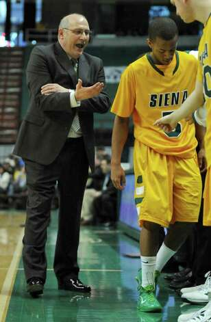 Siena head coach Mitch Buonaguro talks to his team as Evan Hymes sits down, during the second half of their 86-75 victory over Canisius at the Times Union Center on Sunday Feb. 26, 2012 in Albany, N.Y. (Philip Kamrass / Times Union ) Photo: Philip Kamrass / 00015373M