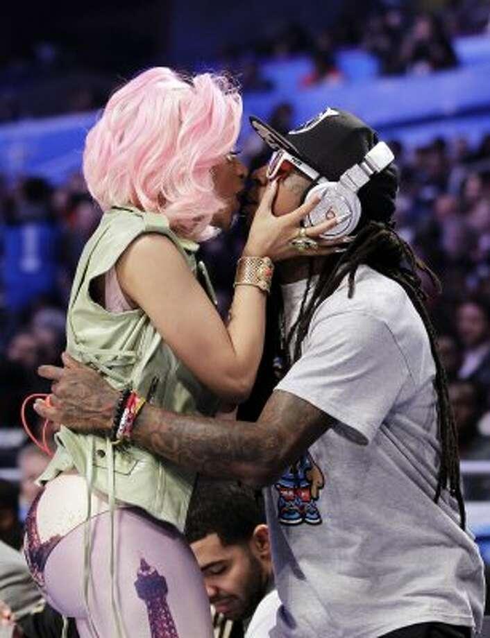 Singer Nicki Minaj, left, greets rapper Lil Wayne during the first half. (Chris O\\\\\\\'Meara / Associated Press)