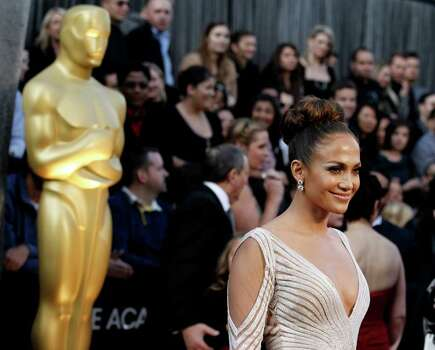 Actress Jennifer Lopez arrives before the 84th Academy Awards on Sunday, Feb. 26, 2012, in the Hollywood section of Los Angeles. (AP Photo/Matt Sayles) Photo: Matt Sayles, Associated Press / AP