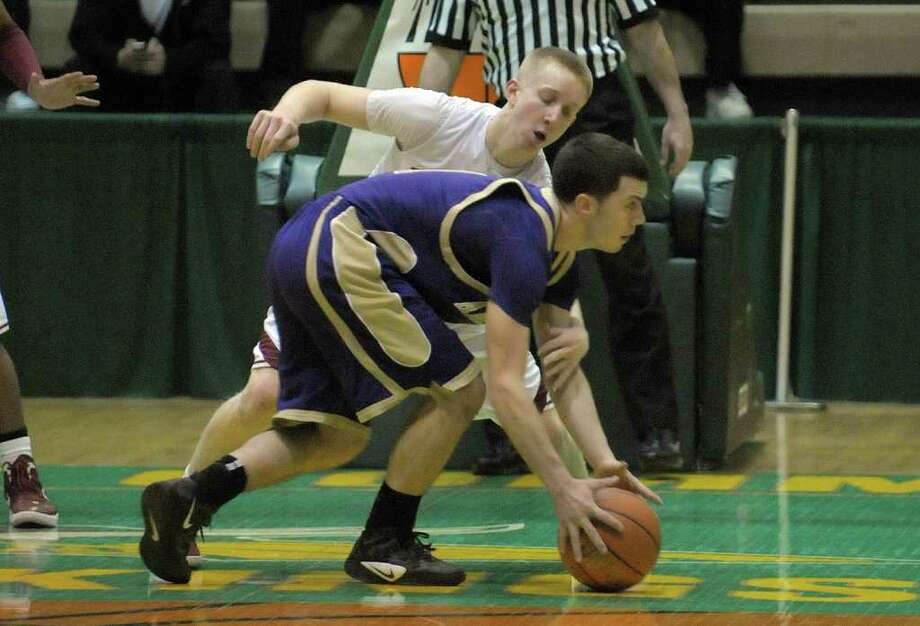 Vinny Sobkowich  of Amsterdam, foreground, tries to keep the ball from Pat Caruso  of Bishop Gibbons during their Class A boys' basketball quarterfinal at the McDonough Complex at Hudson Valley Community College on Sunday, Feb. 26, 2012 in Troy, NY.  Bishop Gibbons defeated Amsterdam.  (Paul Buckowski / Times Union) Photo: Paul Buckowski